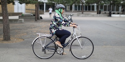 Person on a cycle in a cycle skills session