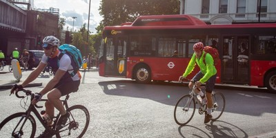 cyclists and bus