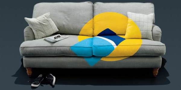 Oyster card and yellow card reader app logo on a sofa